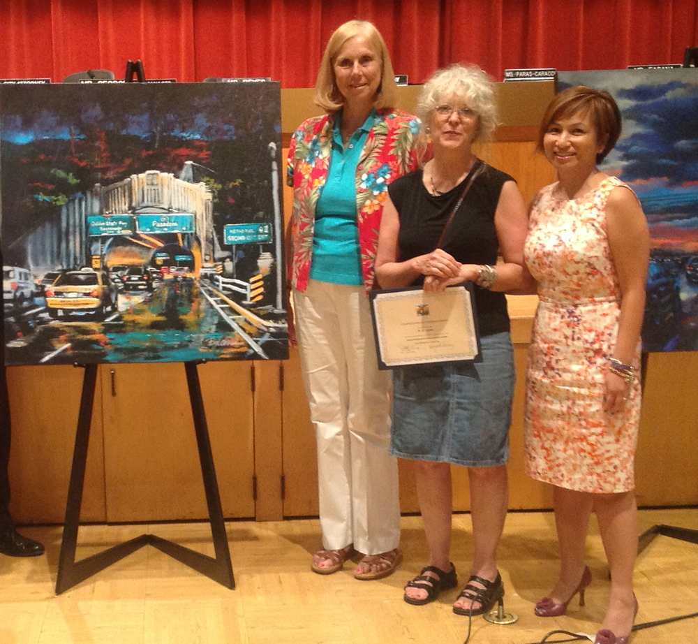 Mayor Margaret Finlay, Duarte artist BJ Kostyk and Councilmember Tzeitel Paras Caracci at a city council meeting where Ms. Kostyk's work was displayed.