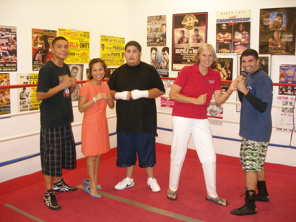 Councilmember Tzeitel Paras Caracci and Mayor Margaret Finlay with members of the Duarte Boxing Team.