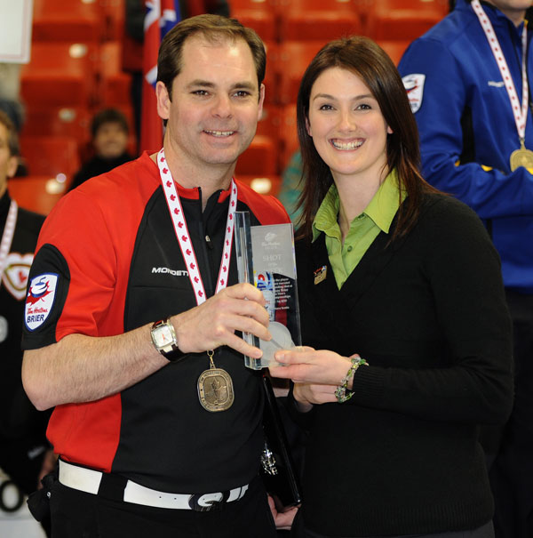 Hart accepts the Tim Hortons Brier Shot of the Week Award at the 2010 Brier.   CCA Photo