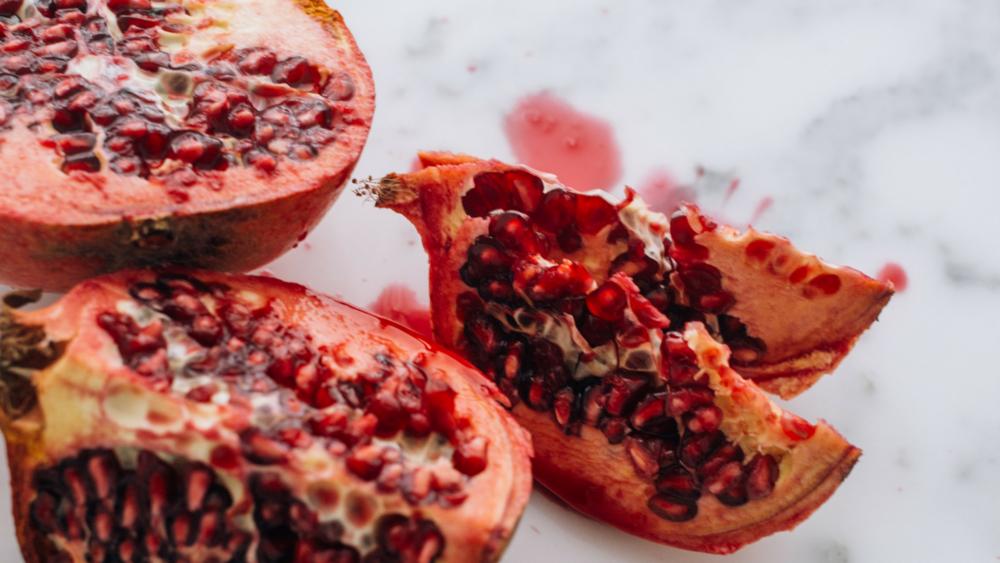 Photo Credit: Charles Deluvio via Unsplash - Vit C in pommegranate: 10.2mg/100g