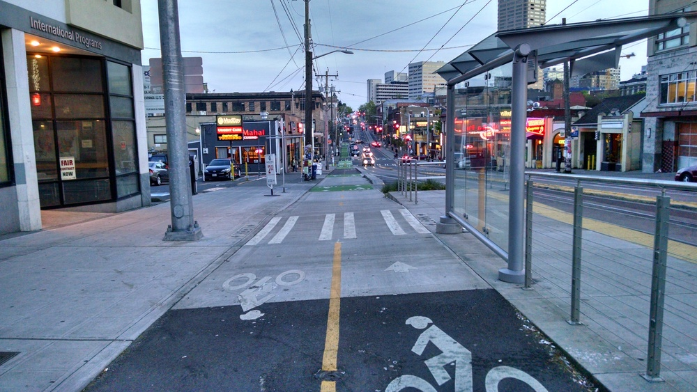Two-way protected bike lanes on Broadway at Pine, in Seattle. Photo By: Dan Sommerville