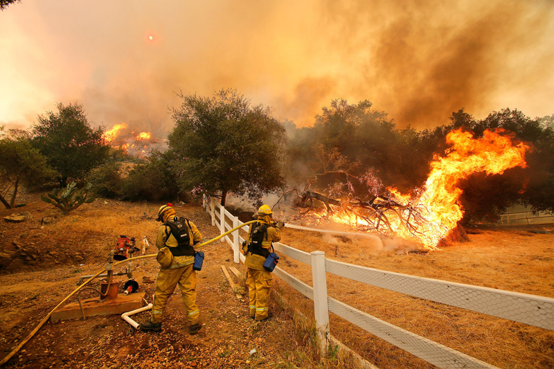 Firefighters work to extinguish a blaze in Hidden Valley, California. Wildfires are endemic to the California wilderness, but they have the potential to occur almost anywhere. (All photos licensed through Creative Commons)