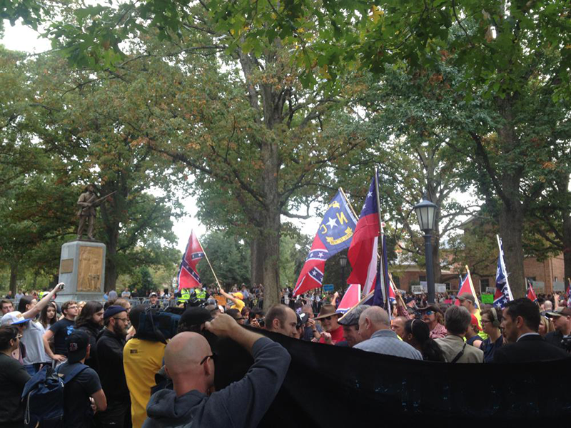 Silent Sam watches as counter-protesters greet Confederate rally protesters in October, 2015. (Photo: Libbie Weimer)