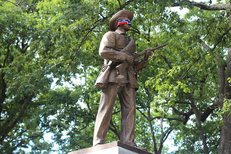 """Silent Sam blindfolded by Confederate battle flag."" (Photo: Bradley Sacks, The Daily Tar Heel)"