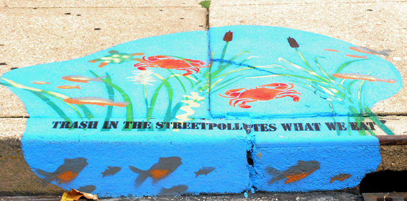 The organization Blue Water Baltimore has involved the Baltimore public in decorating storm drains with educational art about the environmental impacts of waste. (Source: Pinterest)