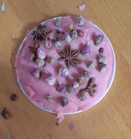 Flowers, spices and berries pressed into a base of lavender scented playdough for a calming, centering activity.