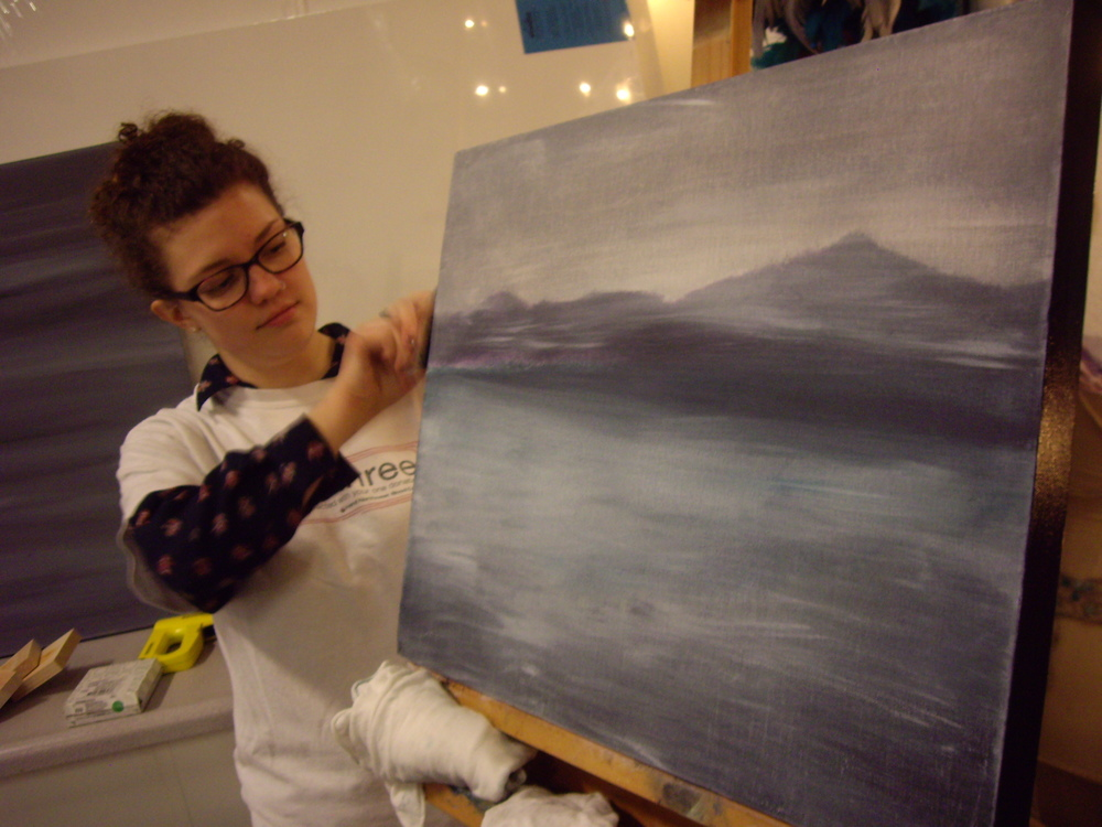 Sierra paints the edges of her gorgeous fogscape! She used a rag to remove layers of acrylic after building them up to get some beautiful affects.