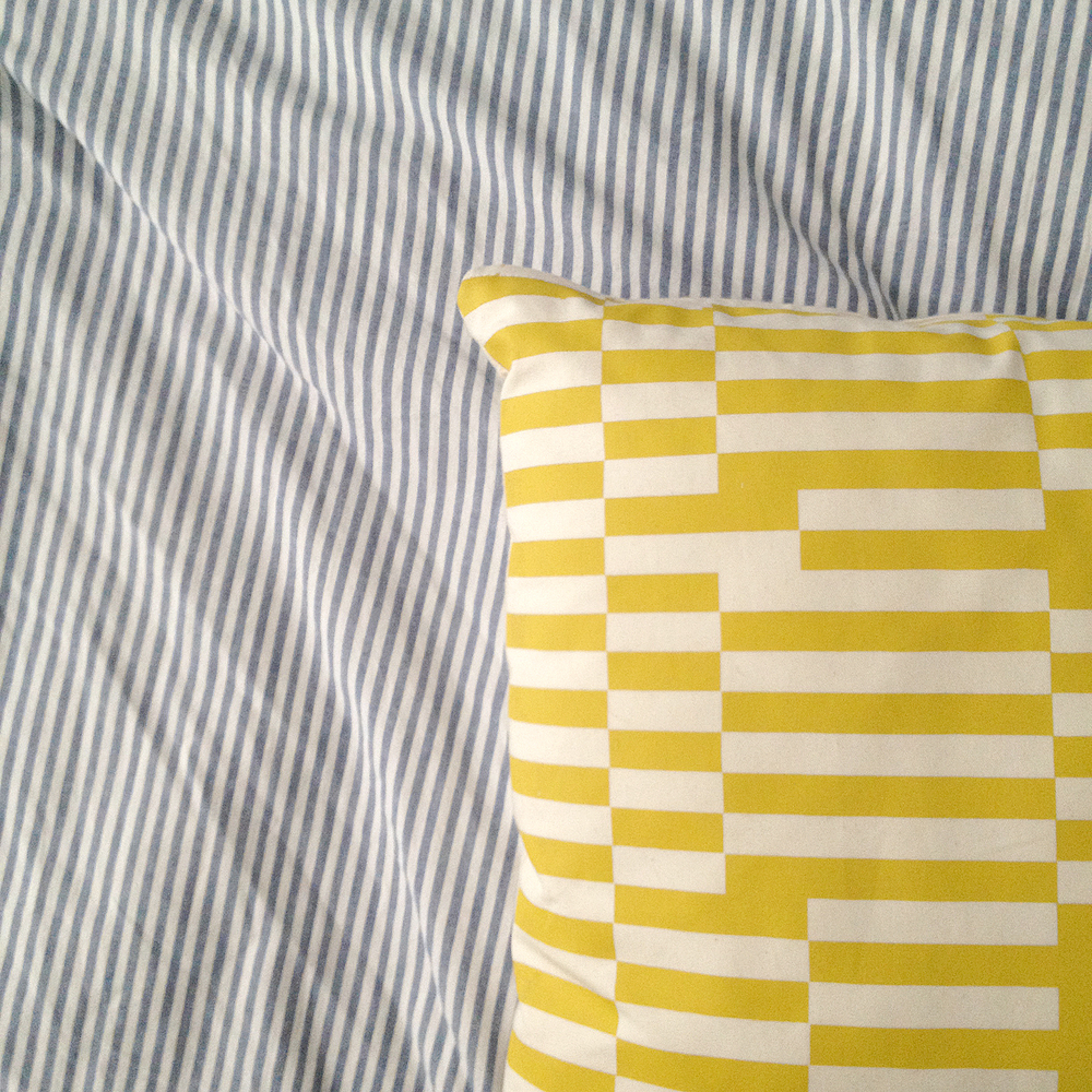 machine made duvet cover and handmade silkscreened pillow by AU RETOUR, a company started by a grad school friend