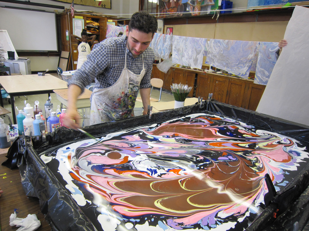 Jason Rondinelli at work marbling paper for his sculptures.