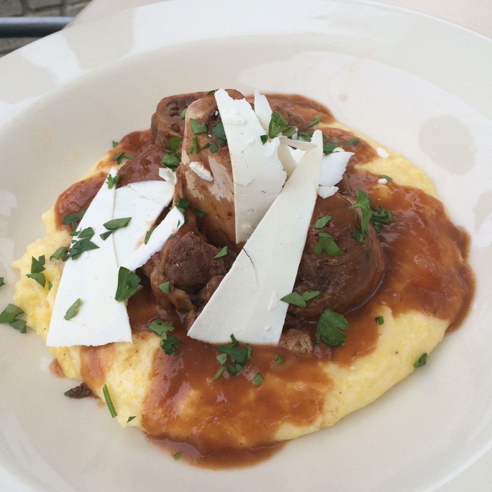 Braised pork shank with polenta