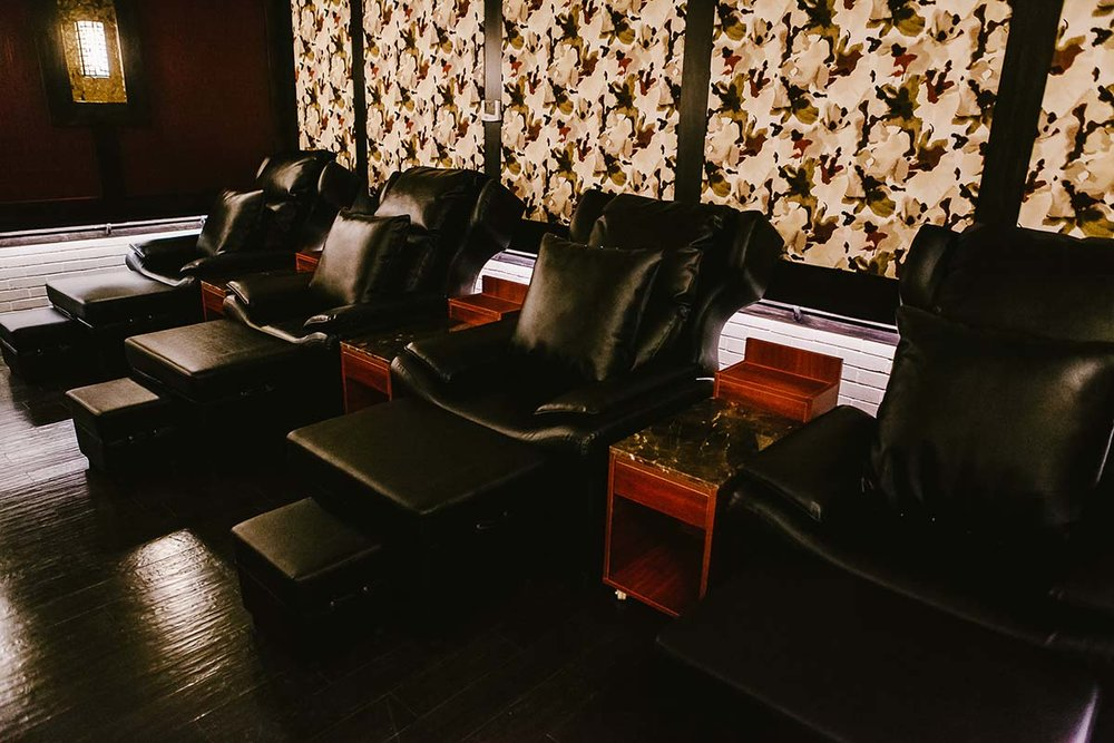 One of the foot massage rooms. Dimly lit during treatment hours.