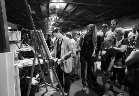 Cecilia giving live painting demonstration at Wednesday Night Market, 2011