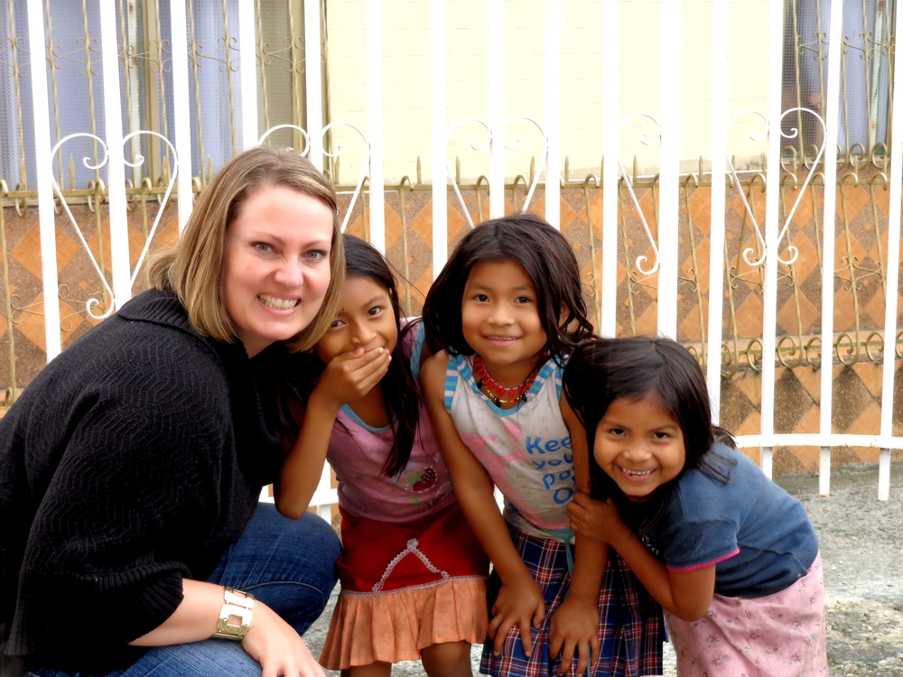 Shelley Actis (co-founder) with three Indigenous girls from the  Embera Chami  tribe in Colombia, S. America.