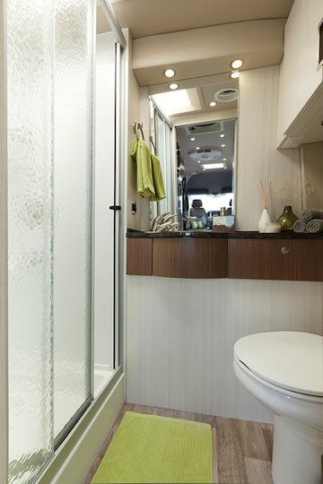 The only Class B motorhome with a full bath.  Corian vanity, porcelain toilet and walk-in shower with skylight. On-demand hot water heater, of course.