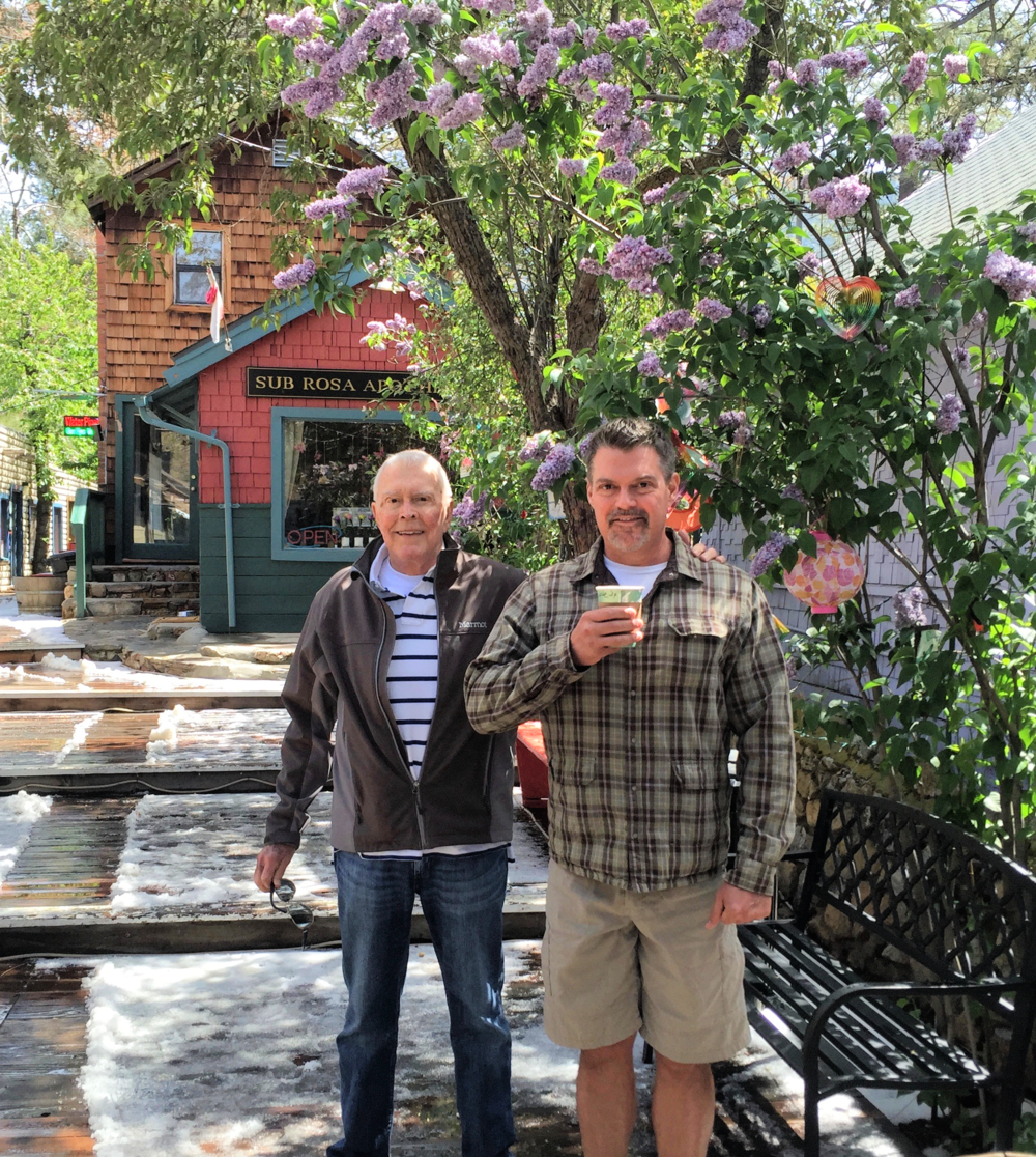 A touch of Spring snow melts as the lilac blooms, next to Idyllwild Bake Shop.