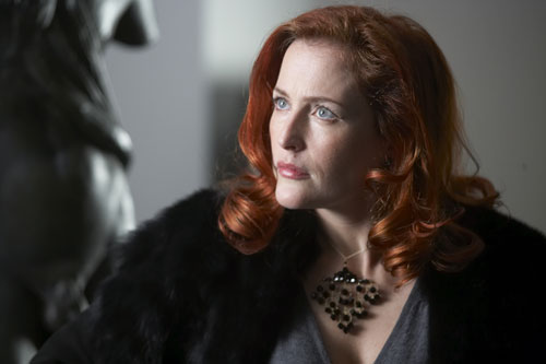 Gillian Anderson as art collector Jean Maclestone.    Scully's red hair always caught my attention even when she was starring in X-Files.