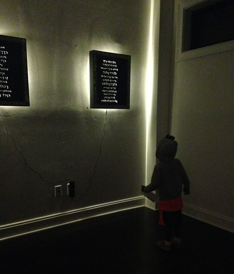 Young spectator gazing at the glowing rap verses. March 15th 2015, 94 Spring St. Charleston SC