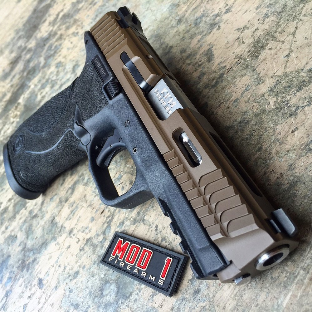 MOD 1 M&P TE    Full Grip Texture With Undercut, Straight Cut Serrations, M&P Front High Serrations, Slide Stamping Removed, Cerakote Refinish, Apex Poly Trigger, KKM Precision Barrel.