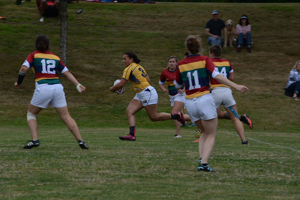 Fehi breaks through ORSU's defensive line.  Photo credit unknown (let us know!)