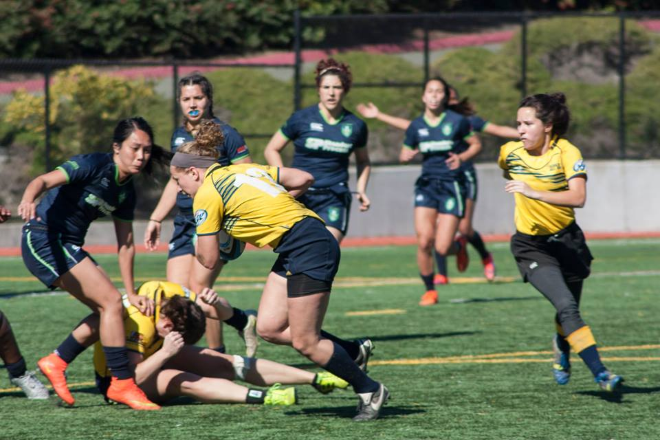 DC getting low to go into contact, with teammate Bean in support during the most recent D2 season game vs. Life West Gladiatrix.