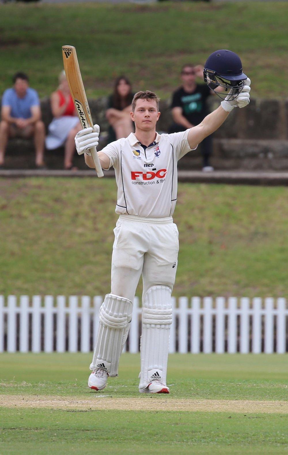 Sydney University's Hayden Kerr celebrates a maiden 1st Grade ton against Randwick-Petersham at Petersham Oval