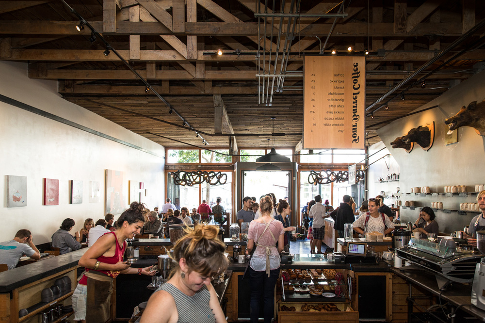 All smiles behind the bar at Four Barrel's Valencia Street location.