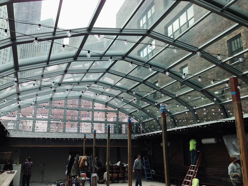 Crews working on the future Il Tetto rooftop beer garden opening Spring 2014 — the glass roof fully retracts to expose diners to the amazing elevated view of the Cultural District in warm weather