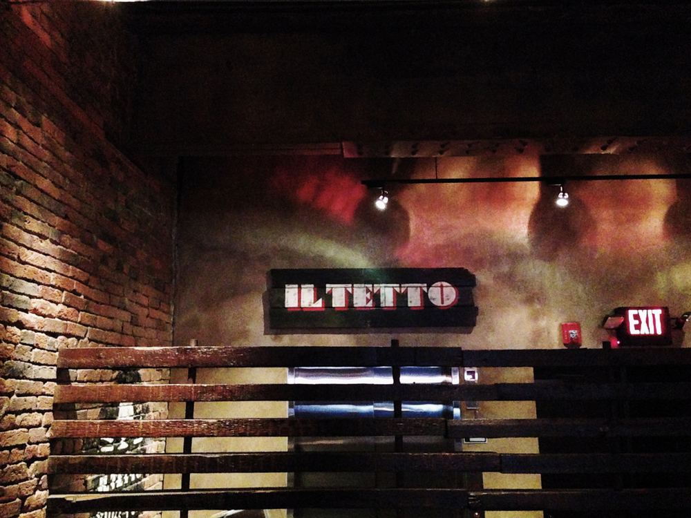 The hand-drawn Il Tetto wordmark above the elevator to the soon-to-be rooftop beer garden level