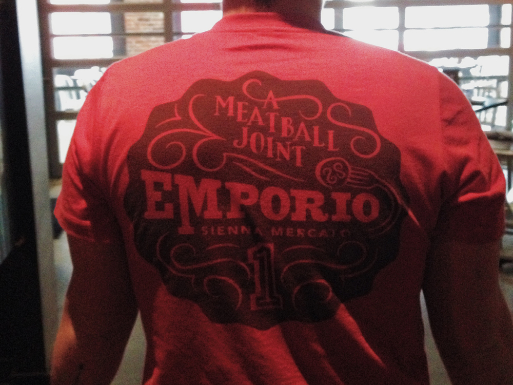 The hand-drawn Emporio seal screenprinted on the servers' shirts