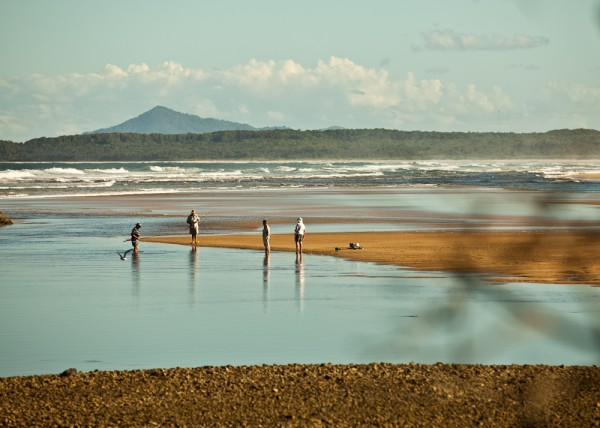 fisherman at the beach in sawtell by simon pollock