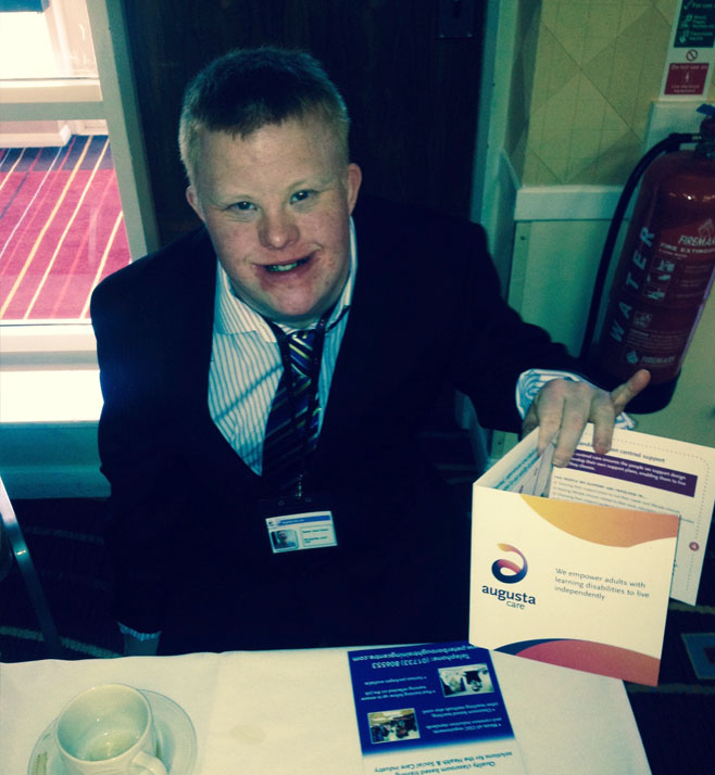 Adam hands out Augusta brochures at a recent job fair recruitment stand