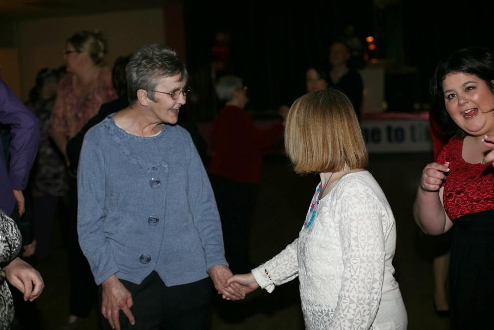 Pauline dances with friends