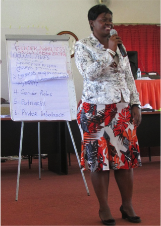 Educate! Program Coordinator Jane Sebuyungo facilitating the Gender Training in Mbale. Jane received her Master's Degree in Gender.