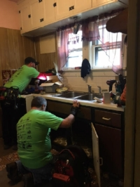 Tri-City Volunteers installing new cabinets