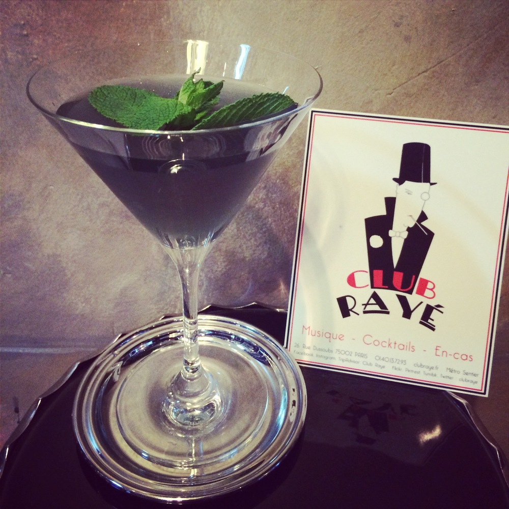 Club Rayé Barmen Marco says : Pourquoi pas ? Squid Ink,a Vodka,Apricot,Lime and Blue curaçao mix,to hide you from the daily stress.