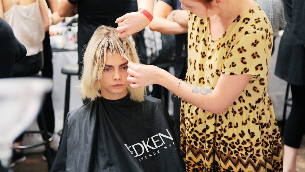 Cara Delevingne getting a trim backstage at Marc Jacobs SS14