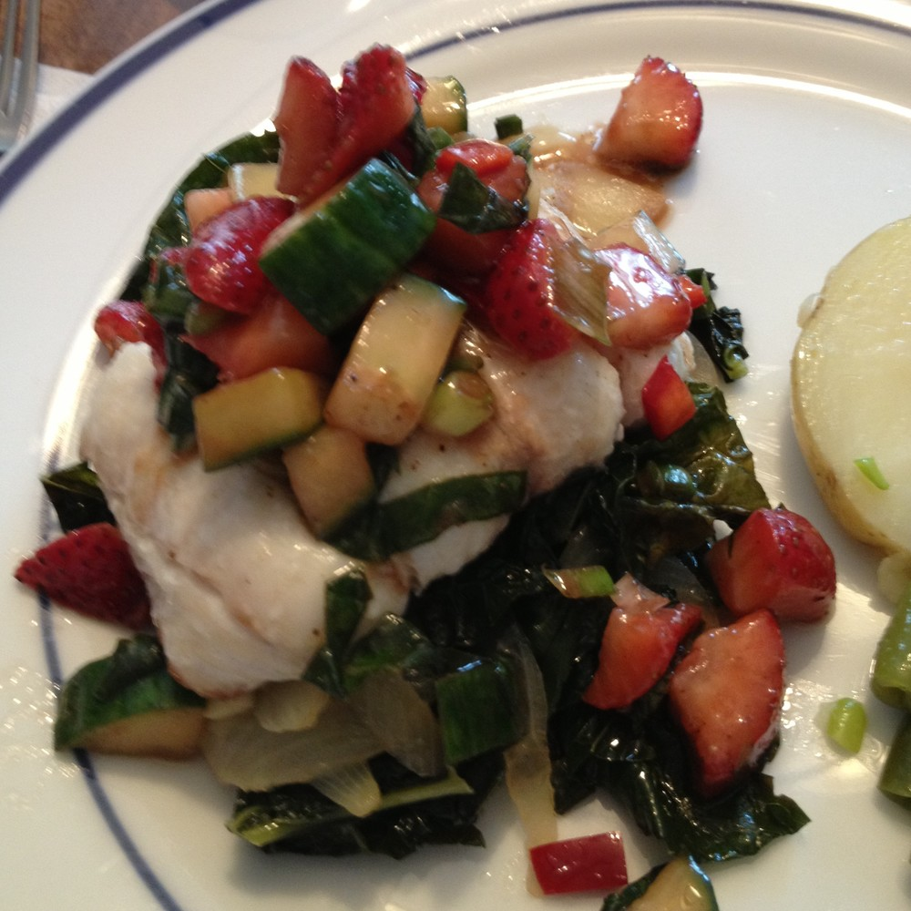 Pan-seared hake over sauteed kale topped with strawberry basil salsa from JenniferJuniper.net