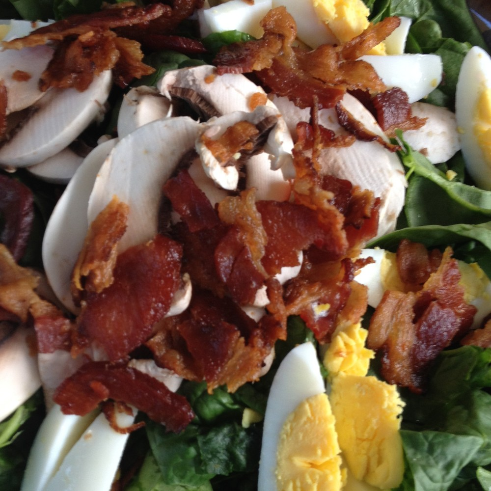 Some dishes are classics for a reason: rich eggs and bacon balanced with crisp spinach and tangy dressing make a great spinach salad.