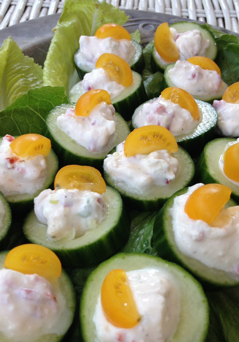 Cucumbers topped with Feta, yogurt, chili & scallion, garnished with tiny slices of yellow tomato. Fresh, light & perfect for summer parties.