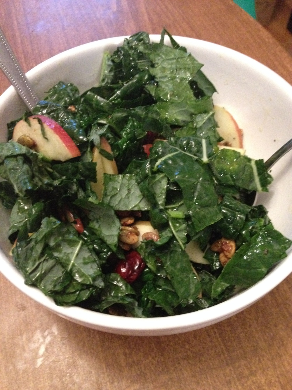Kale, apples, dried cranberries and candied pepitas with cider dressing