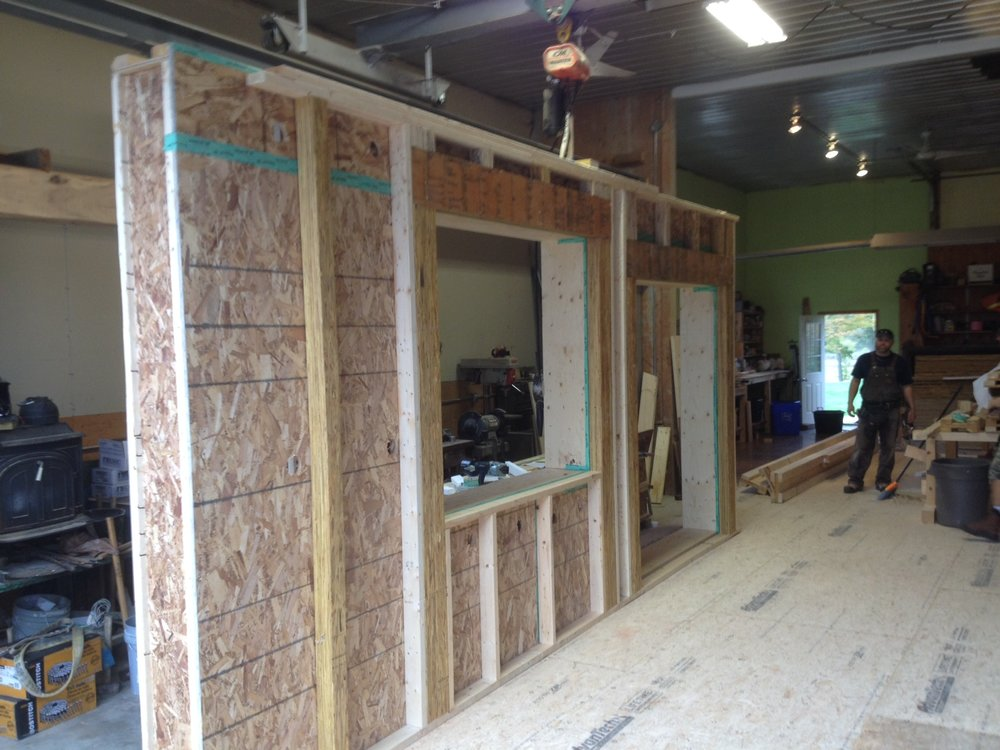 Building the shell - Walls are prefabricated and completed in the shop ready for transport.
