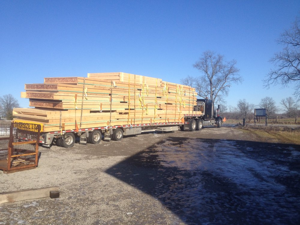 On route to the site - The walls once completed are loaded on the truck and head to the construction site.