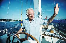 Walter Cronkite, CBS newsman, at the wheel of his beloved Windje yacht.
