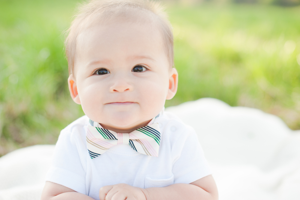 """I love the closeup of his face, the sweetness in his eyes, and the little bow tie. This picture makes me just wanna squeeeezee his little cheeks!""- Ngoc on her favorite portrait"