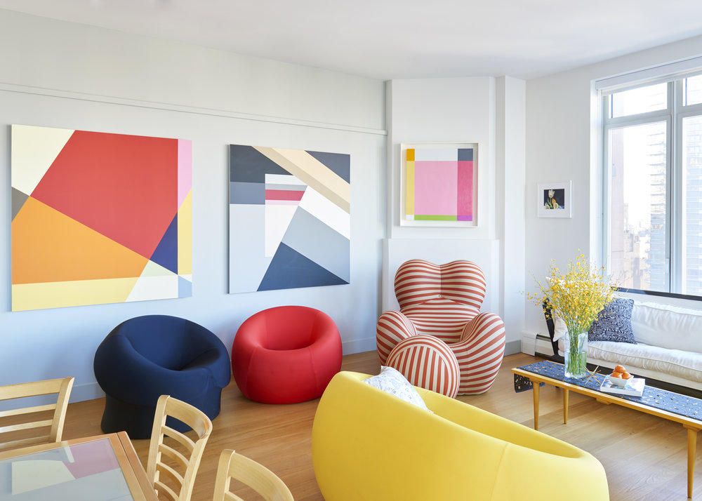 In the living room, Seligson paintings hang over Gaetano Pesce furnishings. Photograph by Kyle Knodell. Courtesy Paddle8.