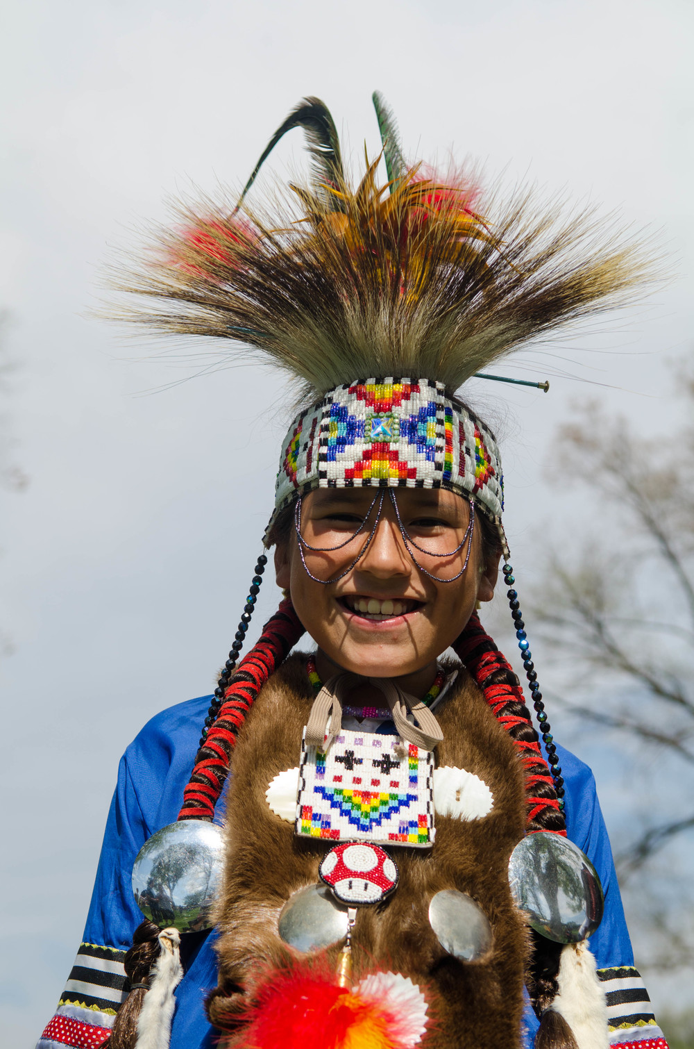 """""""Do you like dressing up for the Pow Wow?"""" """"No."""" """"Does your mom make you do it?"""" """"Yes."""""""