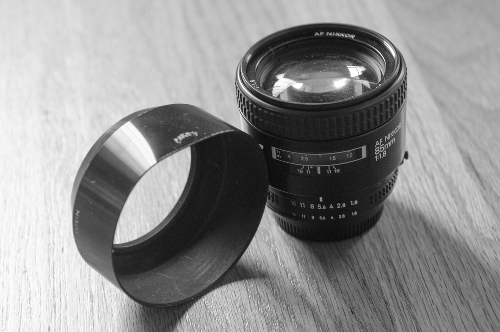 The Nikon 85mm f/1.8 af-D after drop testing.  Notice the bent lens hood and new internal rattle!