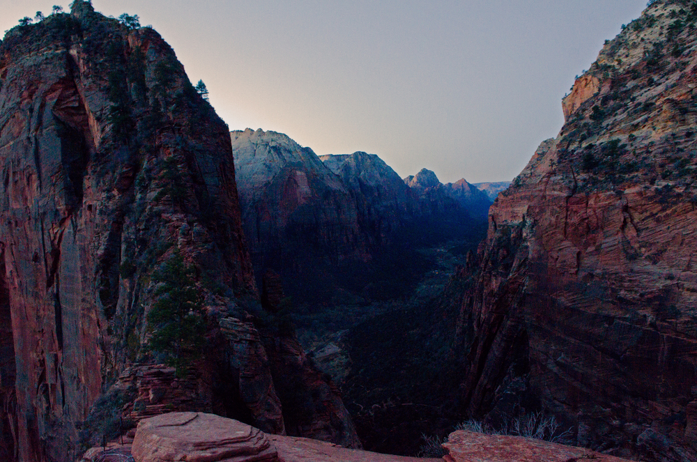 The trail to Angels Landing follows the steep ridge line to the top of the rock on the left.