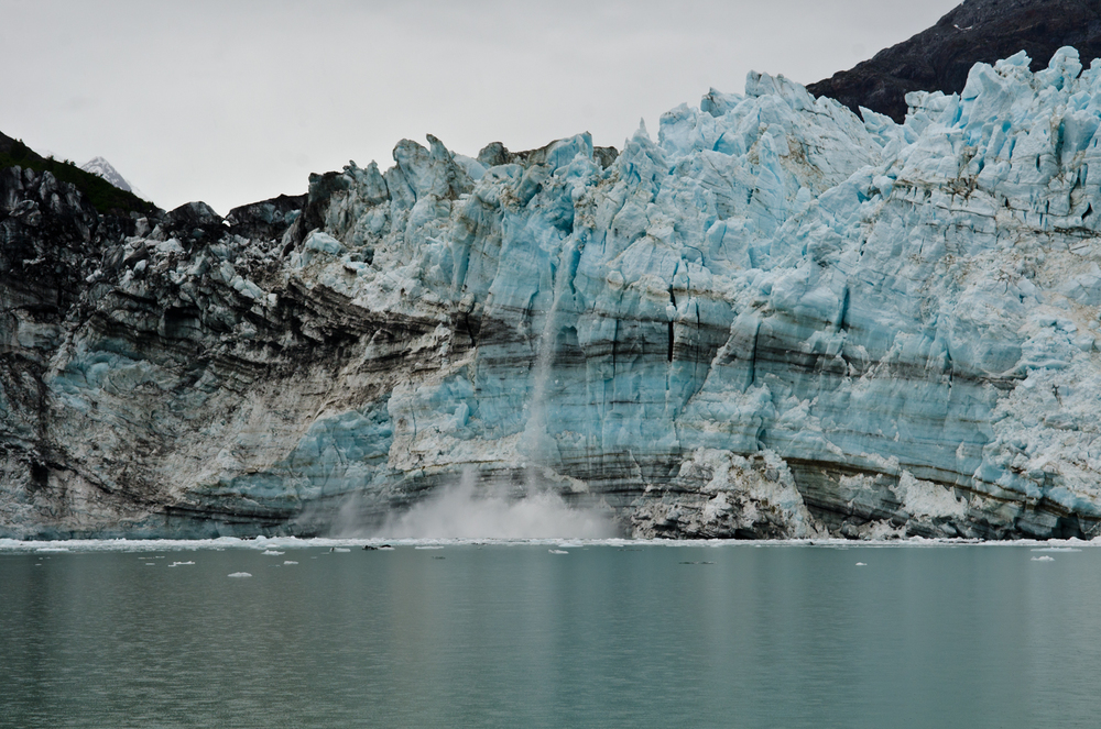 Huge blocks of ice fall from the Margerie Glacier, Tarr Inlet, Glacier Bay, Alaska.