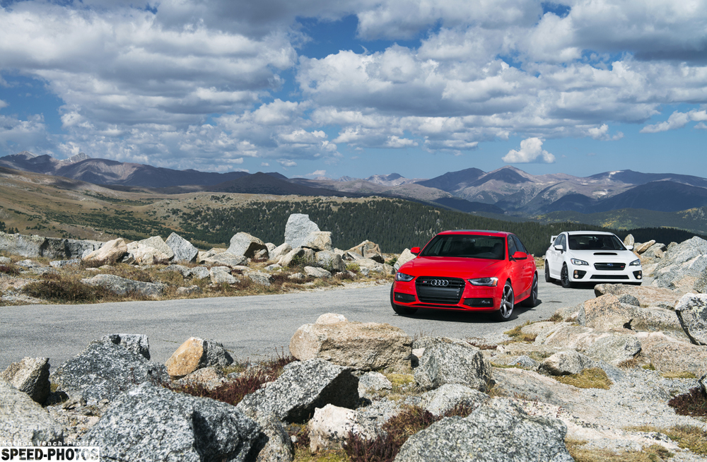 Landscape view of the mountain with the Audi S4 and Subaru STI above treeline.